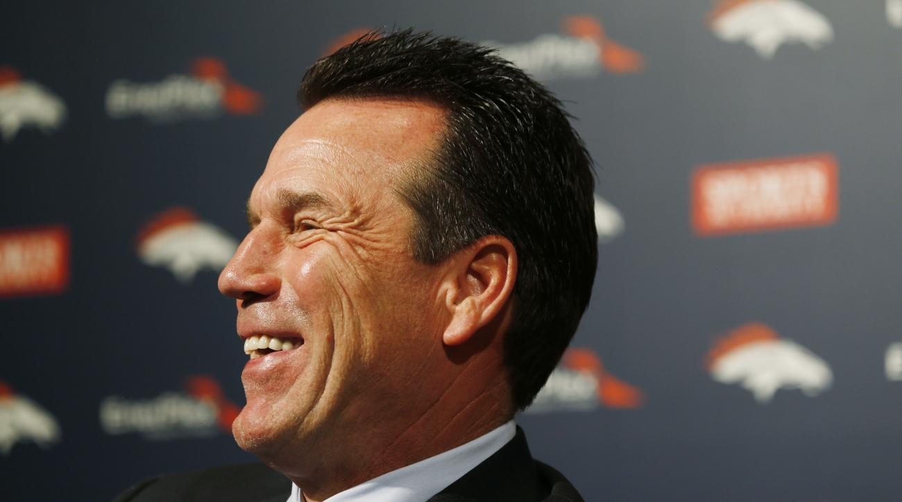 Denver Broncos head coach Gary Kubiak jokes with members of the media while discussing the team's first-round pick in the NFL Draft Thursday, April 30, 2015, in Englewood, Colo. The Broncos traded up from the 28th to the 23rd pick to select Missouri pass