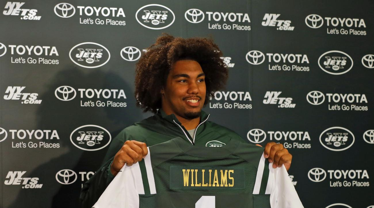 New York Jets draft pick Leonard Williams holds up a jersey as he is introduced to the media at the New York Jets facility Friday, May 1, 2015, in Florham Park, N.J. (AP Photo/Adam Hunger)