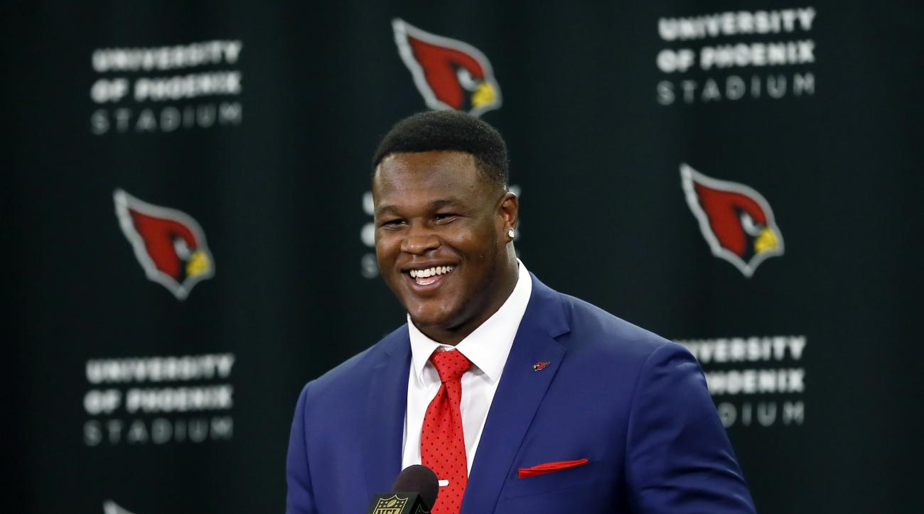 Arizona Cardinals' first-round draft pick D.J. Humphries smiles after being introduced to the media during an NFL football news conference, Friday, May 1, 2015, in Tempe, Ariz. Humphries, a tackle from Florida, was selected 24th overall Thursday night at