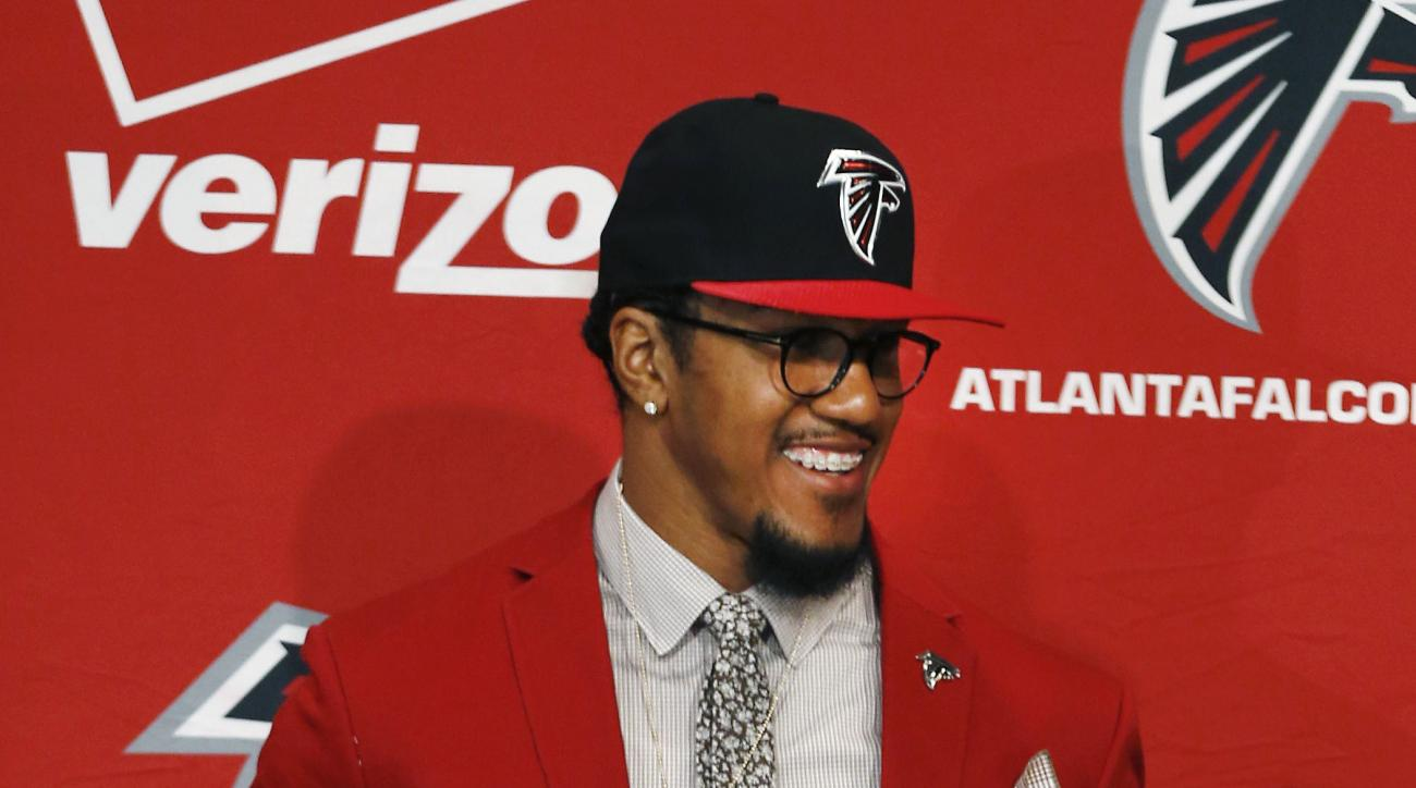 Atlanta Falcons first-round draft pick defensive end Vic Beasley, from Clemson, smiles during a news conference Friday, May 1, 2015, in Flowery Branch, Ga. (AP Photo/John Bazemore)