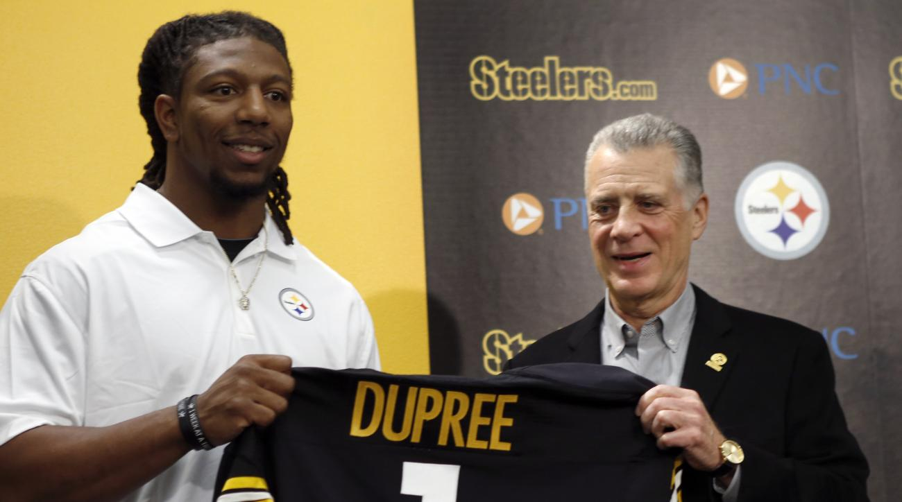 "Alvin ""Bud"" Dupree, a linebacker out of Kentucky, left, poses with a team jersey beside Pittsburgh Steelers President Art Rooney II as he is introduced at a news conference, Friday, May 1, 2015, in Pittsburgh, Depree was chosen by the Pittsburgh Steelers"