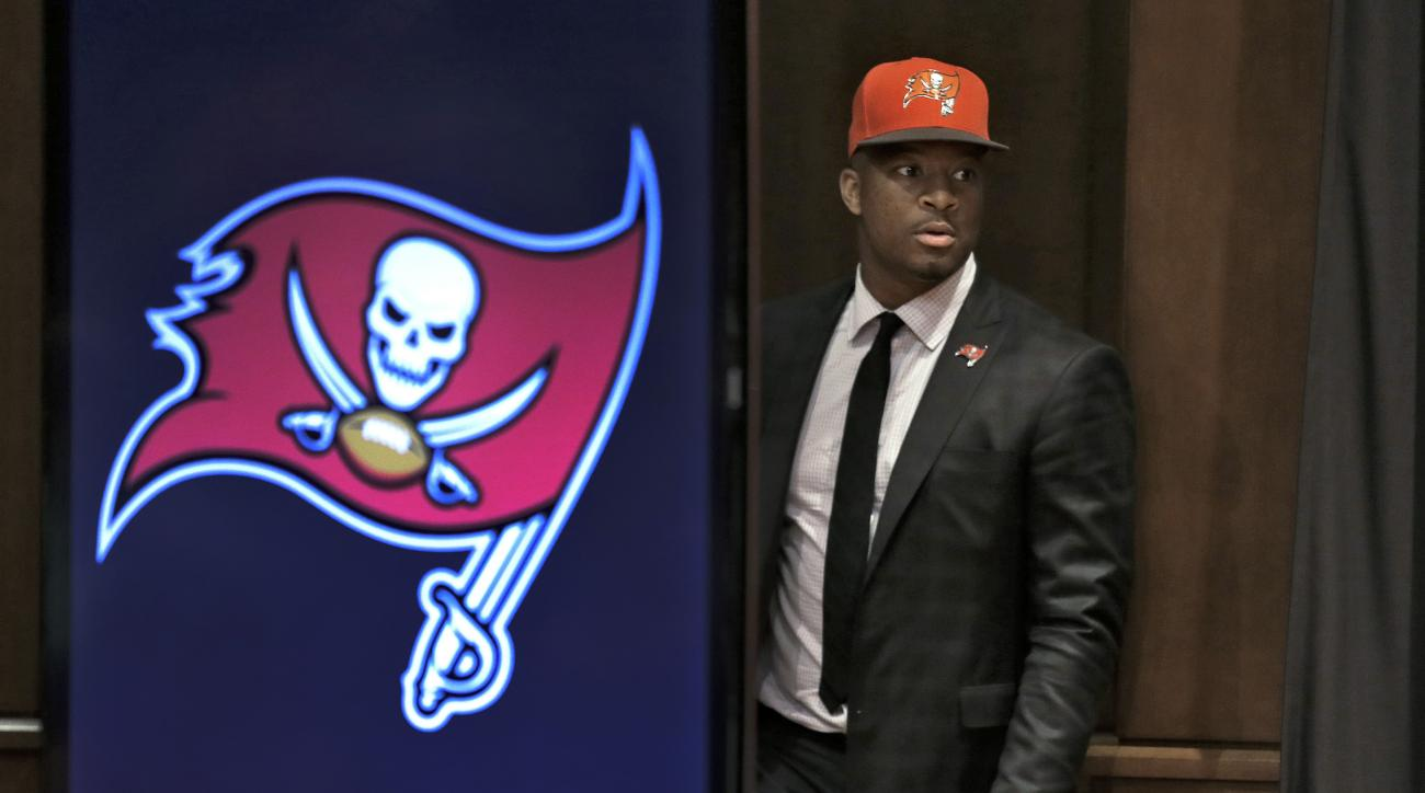 Tampa Bay Buccaneers first-round draft pick Jameis Winston walks onto the stage before a news conference Friday, May 1, 2015, in Tampa, Fla. Winston, a former Florida State quarterback, was the first overall pick. (AP Photo/Chris O'Meara)