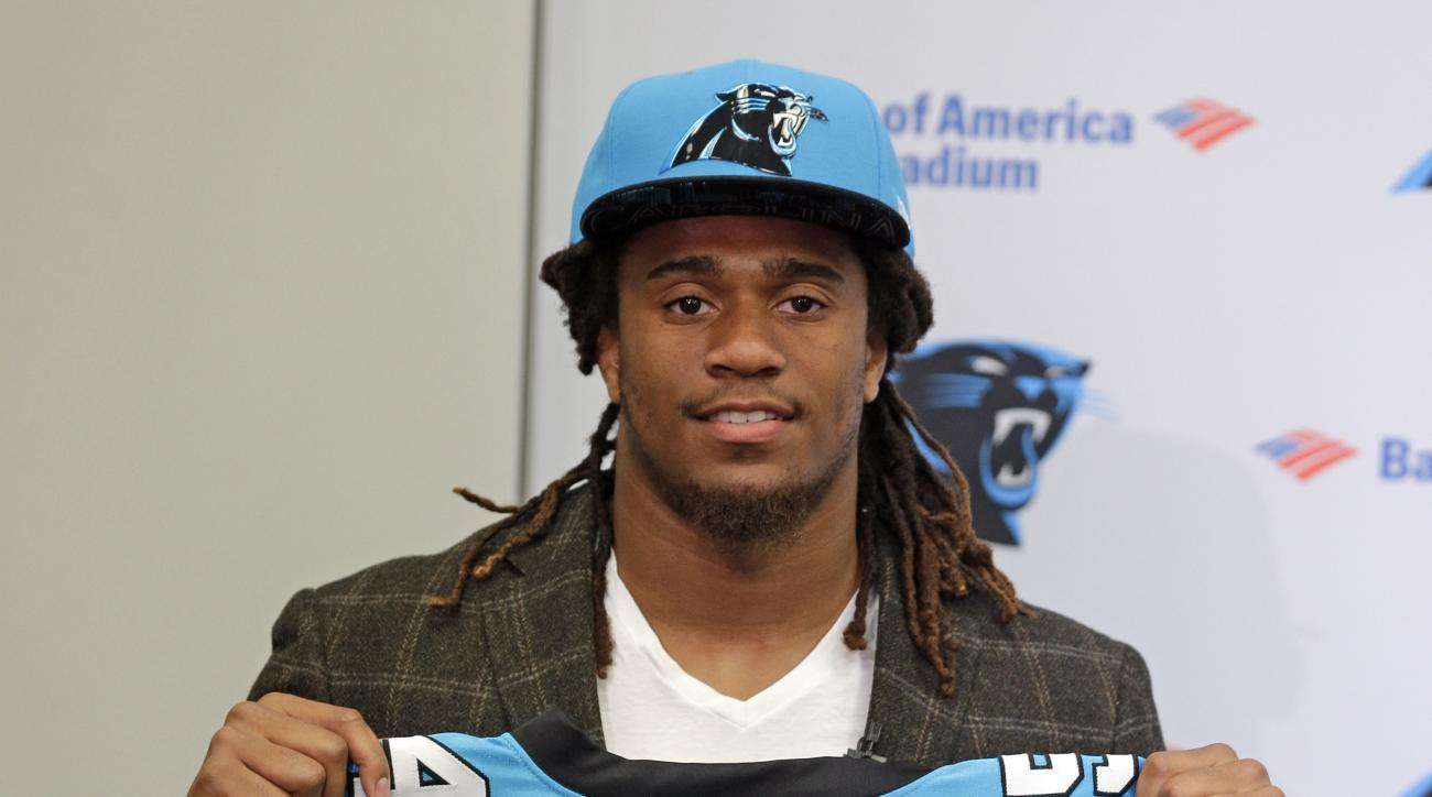 Carolina Panthers first round NFL draft choice Shaq Thompson poses for a photo with his jersey during a news conference in Charlotte, N.C., Friday, May 1, 2015. (AP Photo/Chuck Burton)