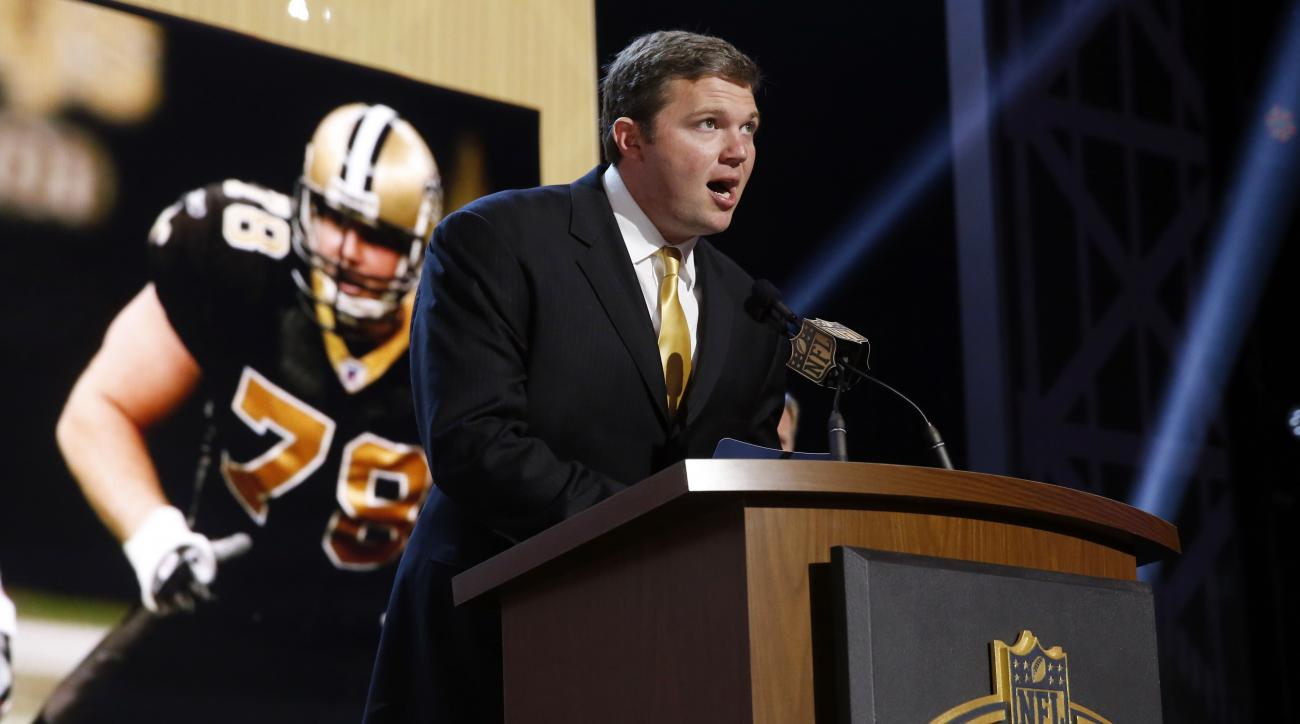 New Orleans Saints offensive tackle Jon Stinchcomb announces that the New Orleans Saints selects Washington linebacker Hau'Oli Kikaha as the 44th pick in the second round of the 2015 NFL Football Draft,  Friday, May 1, 2015, in Chicago. (AP Photo/Charles