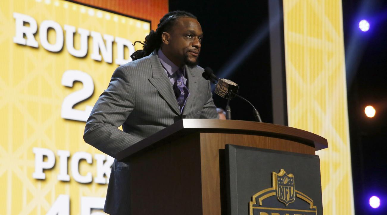 Minnesota Vikings linebacker E.J. Henderson announces that the Vikings selects UCLA linebacker Eric Kendricks as the 45th pick in the second round of the 2015 NFL Football Draft,  Friday, May 1, 2015, in Chicago. (AP Photo/Charles Rex Arbogast)
