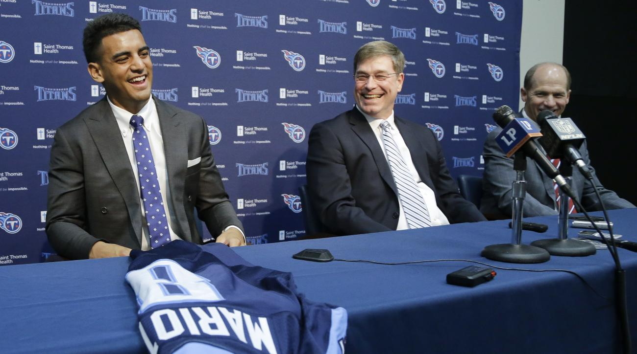 Marcus Mariota, left, former Oregon quarterback and overall No. 2 NFL football draft pick by the Tennessee Titans, answers questions during a news conference Friday, May 1, 2015, in Nashville, Tenn. With Mariota are Titans general manager Ruston Webster,