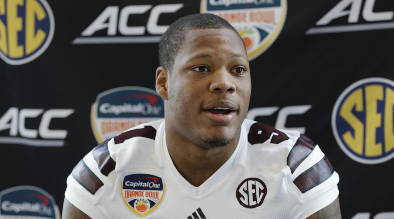 FILE - In this Dec. 29, 2014, file photo, Mississippi State defensive lineman Preston Smith speaks during media da in Miami Gardens, Fla. The Washington Redskins took Smith with the 38th overall pick in the NFL draft, giving them a potential pass-rushing
