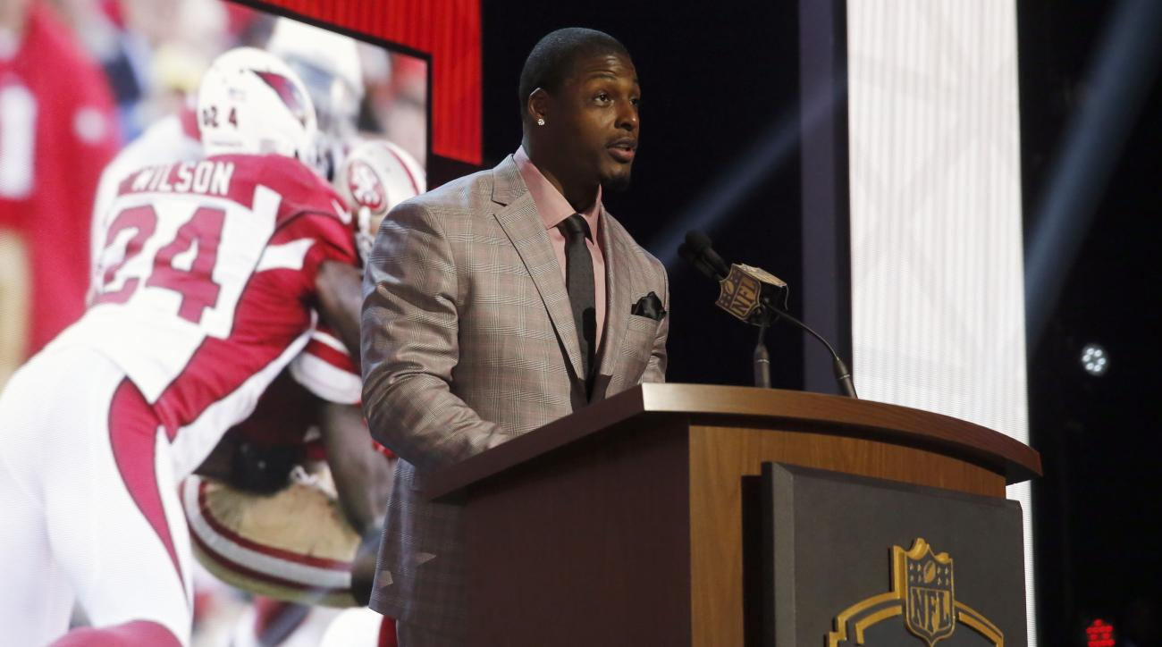 Former NFL player Adrian Wilson announces that the Arizona Cardinals selects Missouri defensive lineman Markus Golden as the 58th pick in the second round of the 2015 NFL Football Draft,  Friday, May 1, 2015, in Chicago. (AP Photo/Charles Rex Arbogast)
