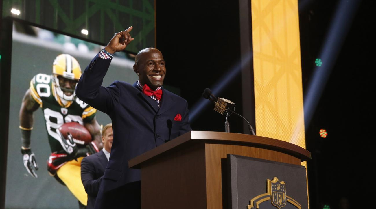 Former Green Bay Packers wide receiver Donald Driver announces that the Packers selects Miami of Ohio defensive back Quinten Rollins as the 62nd pick in the second round of the 2015 NFL Football Draft,  Friday, May 1, 2015, in Chicago. (AP Photo/Charles R