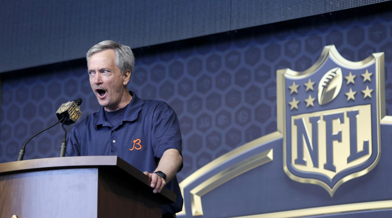 Chicago Bears' Chairman George H. McCaskey hollers out for Bears fans during the last day of the 2015 NFL Draft, Saturday, May 2, 2015, in Chicago. (AP Photo/Charles Rex Arbogast)