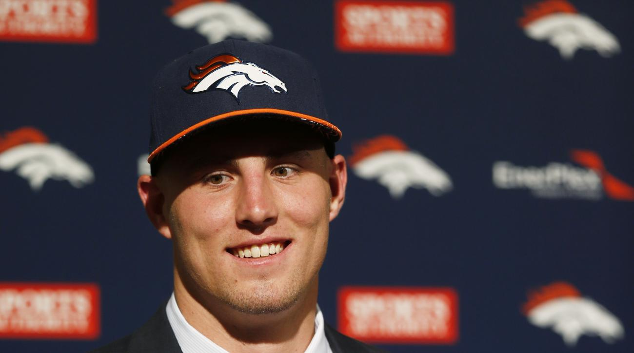 Former Ohio State tight end Jeff Heuerman, the Denver Broncos third-round pick in the NFL Draft, holds up his new jersey during a news conference Saturday, May 2, 2015, in Englewood, Colo. Heuerman was the 92nd pick in the draft, which concludes Saturday.