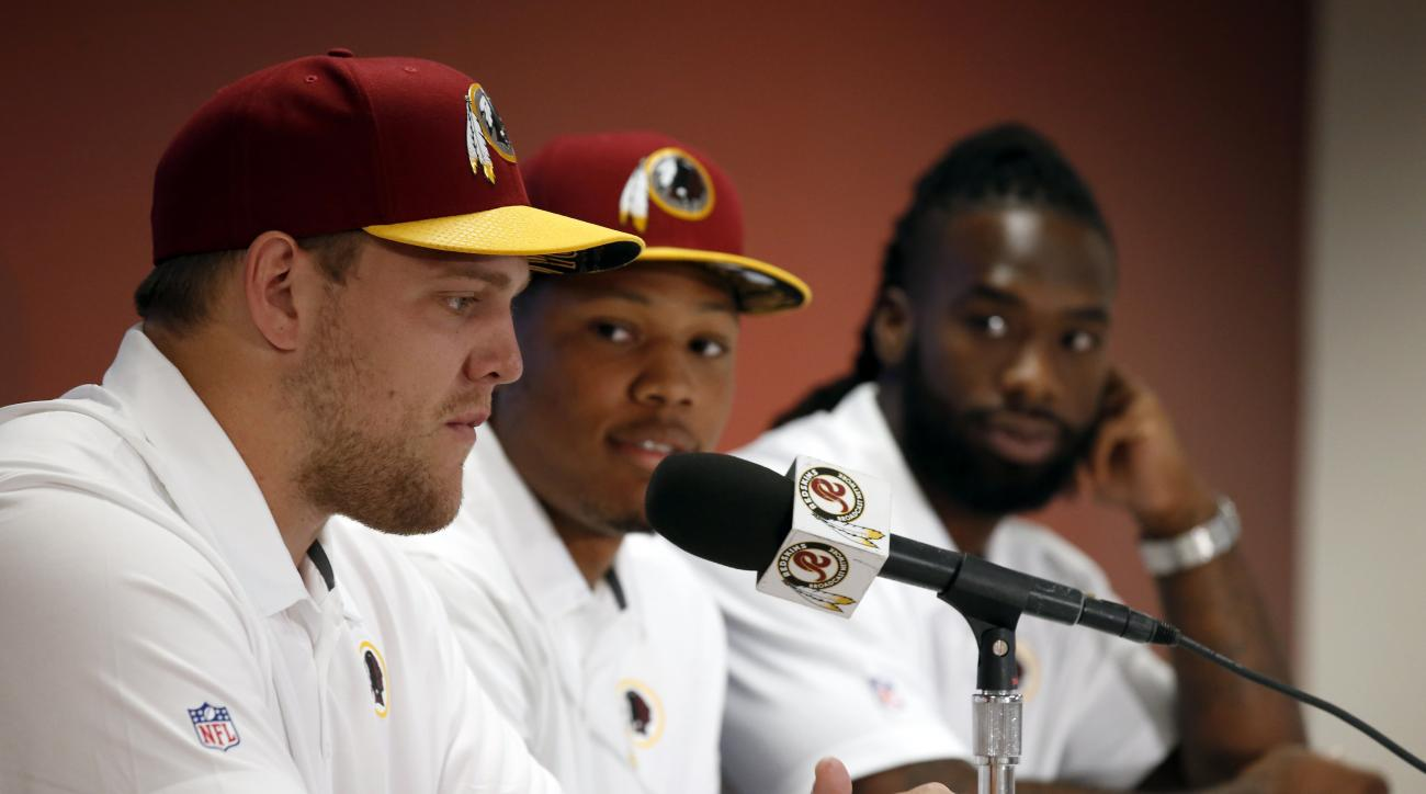 Washington Redskins NFL football draft picks, from left, offensive lineman Brandon Scherff, linebacker Preston Smith, running back Matt Jones, pause while answering questions during a media availability Saturday, May 2, 2015, in Landover, Md. (AP Photo/Al