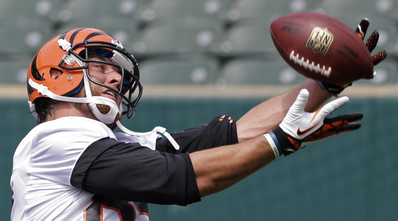 FILE - In this May 27, 2014, file photo, Cincinnati Bengals tight end Tyler Eifert catches a pass during an NFL football organized team activity in Cincinnati. Eifert missed all but part of the season opener last year, costing the Bengals a top receiving