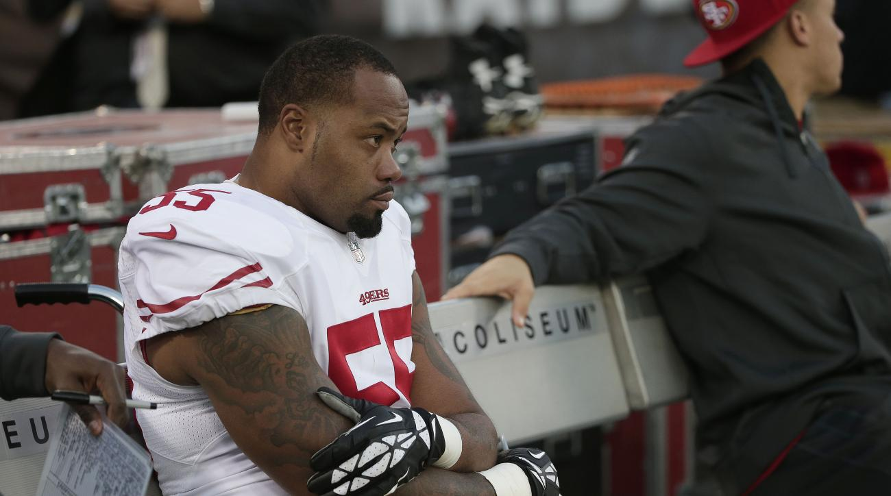 San Francisco 49ers linebacker Ahmad Brooks (55) sits on the bench during the fourth quarter of an NFL football game against the Oakland Raiders in Oakland, Calif., Sunday, Dec. 7, 2014. The Raiders won 24-13. (AP Photo/Marcio Jose Sanchez)