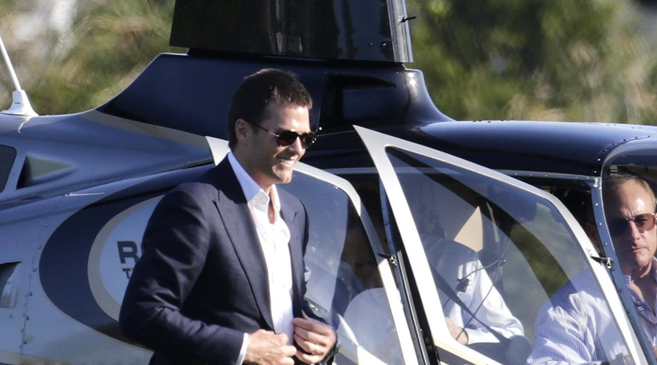 New England Patriots quarterback Tom Brady  arrives by helicopter for a speaking event at Salem State University in Salem, Mass., Thursday, May 7, 2015. An NFL investigation has found that New England Patriots employees likely deflated footballs and that
