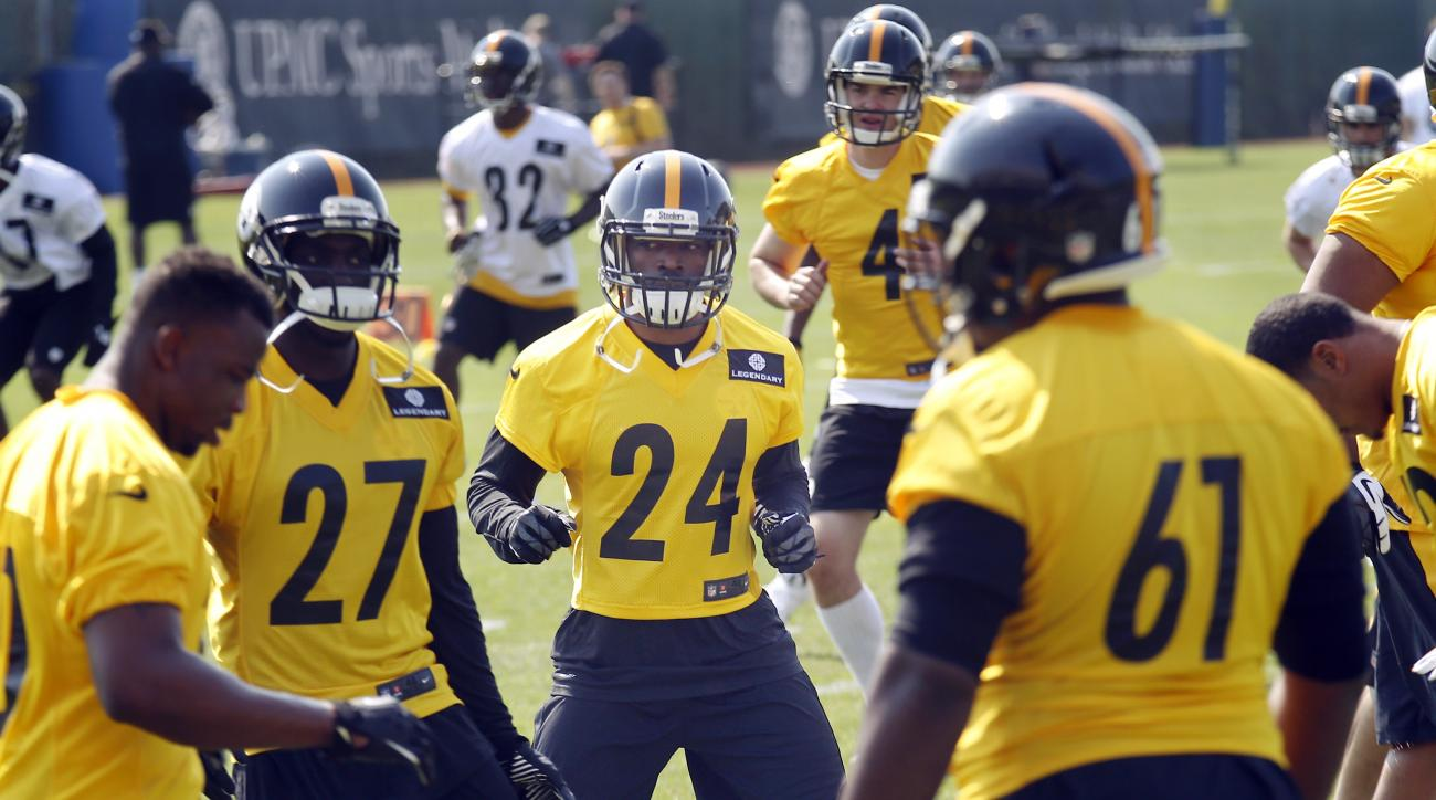 Pittsburgh Steelers fourth round draft pick Doran Grant, (24) a safety out of Ohio State, warms up with the team during an NFL football rookie minicamp, Friday, May 8, 2015, in Pittsburgh. (AP Photo/Keith Srakocic)