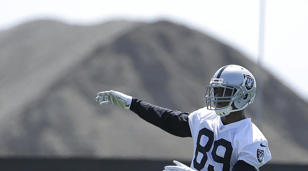 Oakland Raiders wide receiver Amari Cooper stretches during a rookie minicamp at an NFL football facility in Alameda, Calif., Friday, May 8, 2015. (AP Photo/Jeff Chiu)