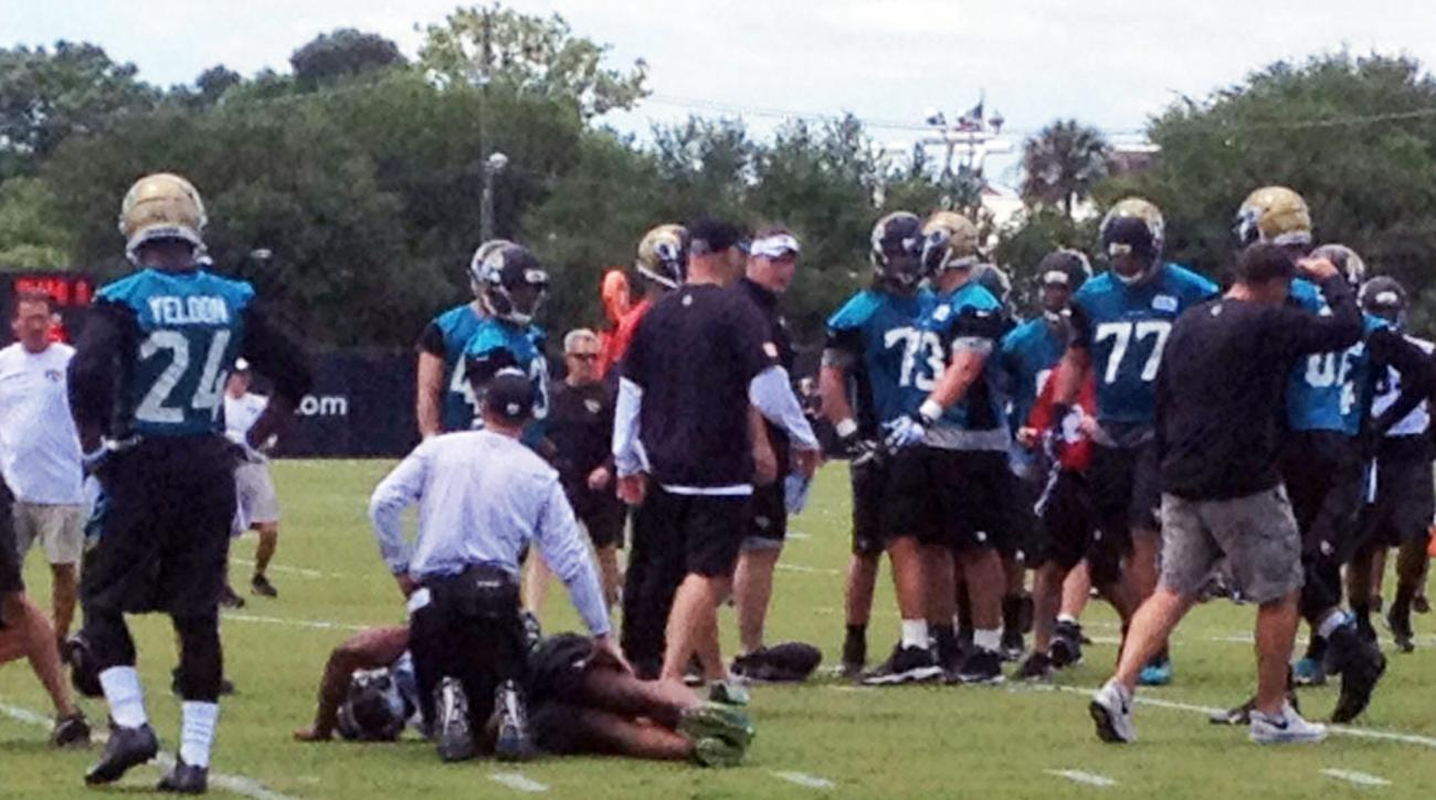 Jacksonville Jaguars first-round draft pick Dante Fowler is tended to after being injured at the teams NFL football minicamp in Jacksonville, Fla., Friday, May 8, 2015. (Ryan O'Halloran/The Florida Times-Union via AP)