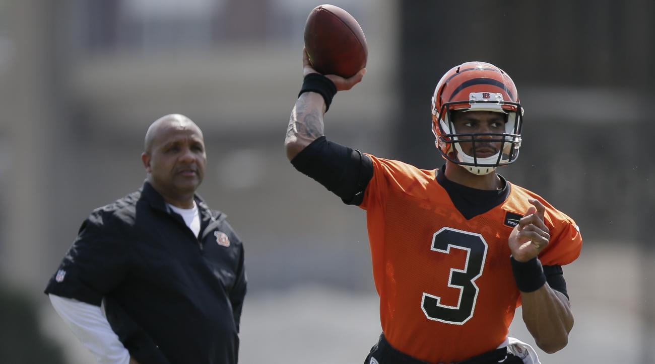 Cincinnati Bengals NFL football rookie quarterback Terrelle Pryor participates in a drill as offensive coordinator Hugh Jackson, left, looks on during NFL football rookie minicamp in Cincinnati, Friday, May 8, 2015. (AP Photo/John Minchillo)