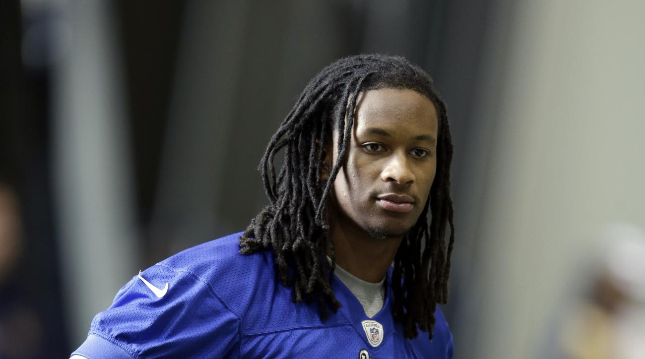 St. Louis Rams running back Todd Gurley, the Rams' top draft pick, watches from the sideline during a rookie minicamp at the NFL football team's practice facility Friday, May 8, 2015, in St. Louis. (AP Photo/Jeff Roberson)