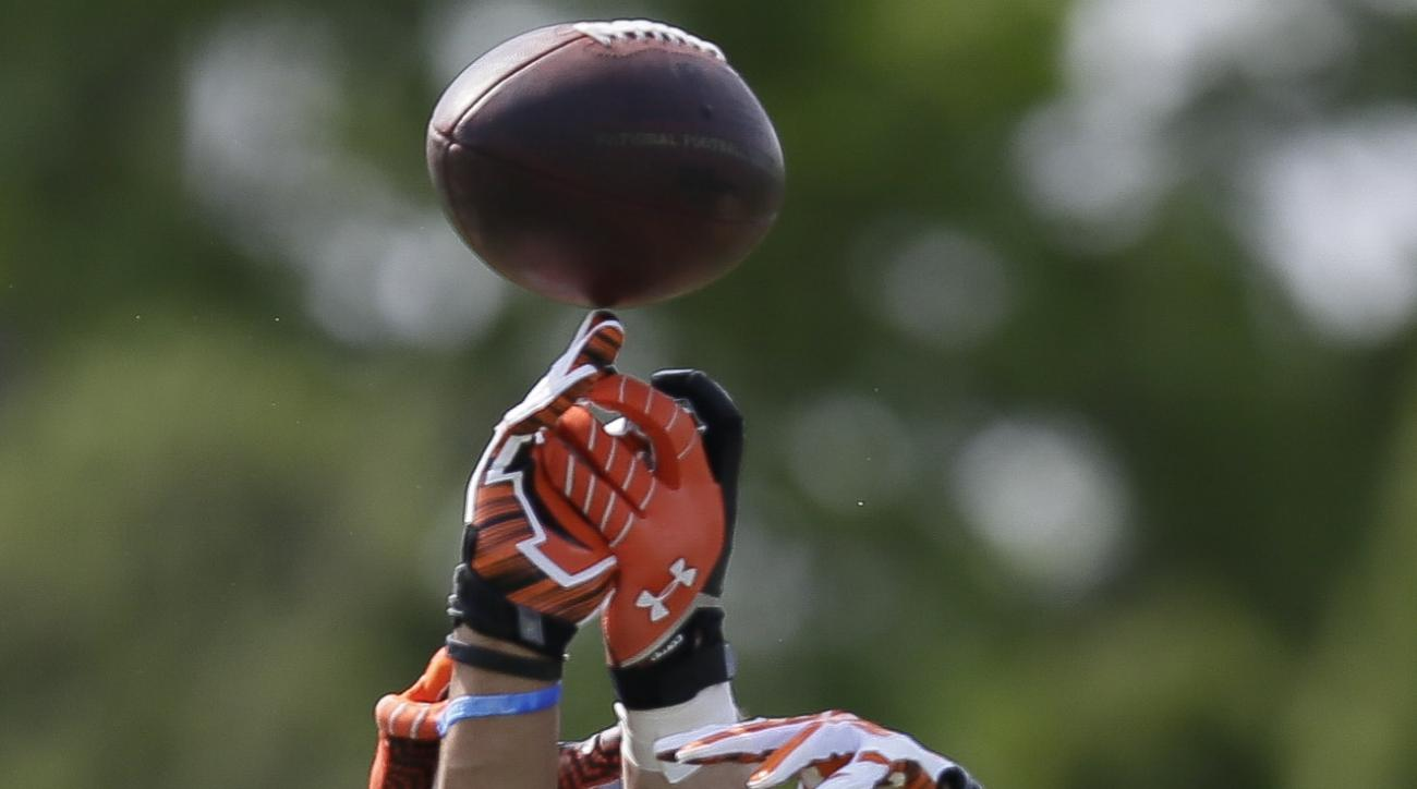Cincinnati Bengals NFL football safety Derron Smith, right, and tight end Matt Lengel reach for a pass during NFL football rookie minicamp in Cincinnati, Friday, May 8, 2015. (AP Photo/John Minchillo)