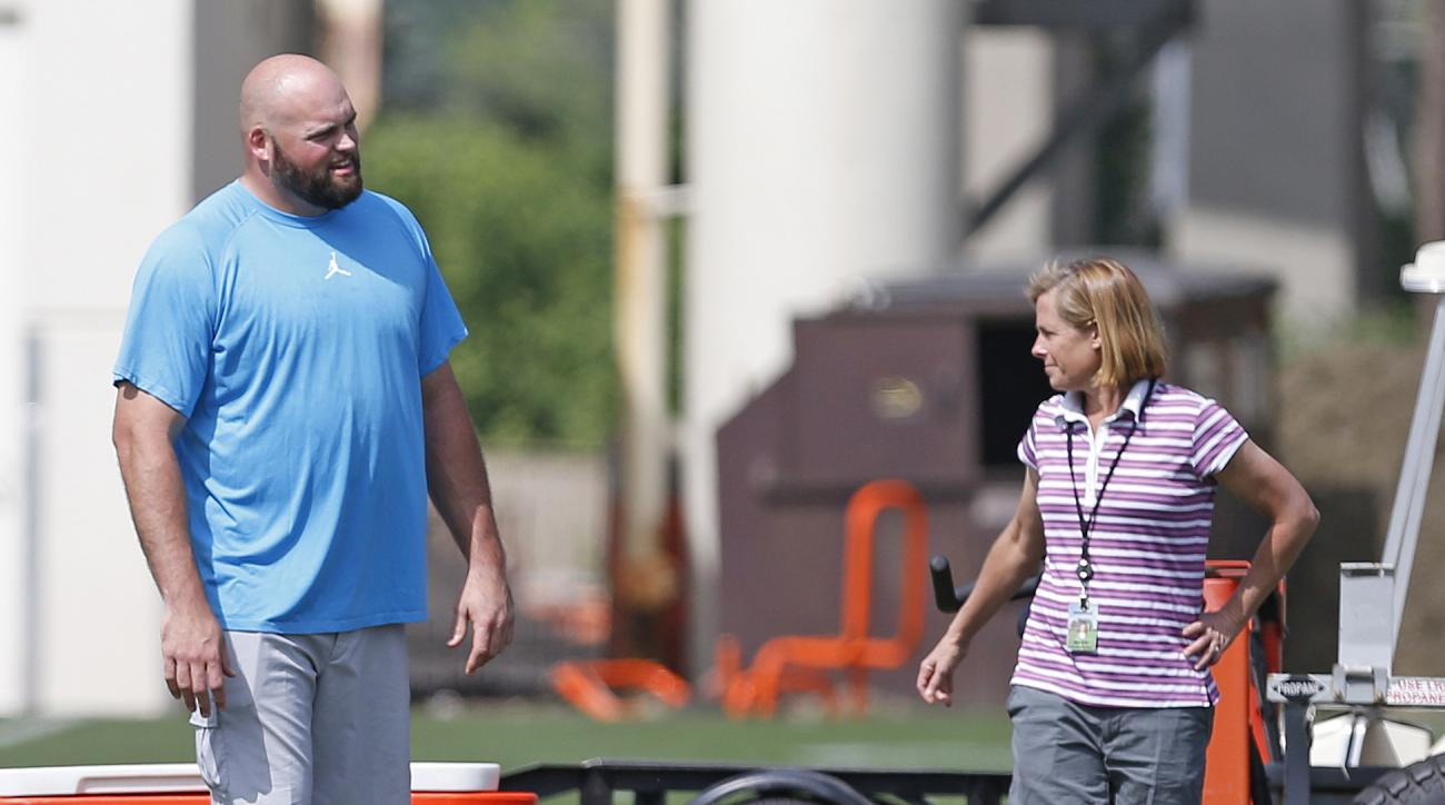 Cincinnati Bengals veteran offensive tackle Andrew Whitworth, left, talks with Katie Blackburn, Executive Vice President of the Bengals, during their NFL football rookie minicamp Saturday, May 9, 2015 in Cincinnati. (AP Photo/Gary Landers)