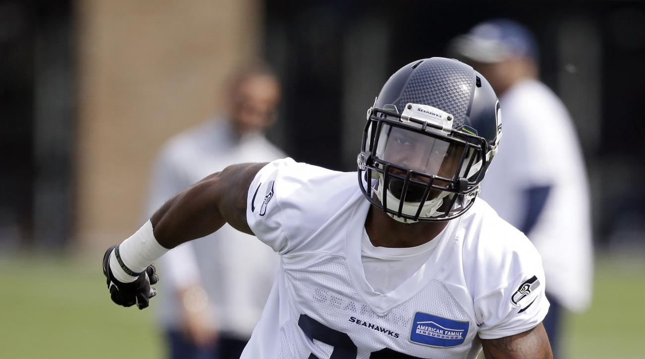 Eric Pinkins runs while taking part in drills at Seattle Seahawks NFL football rookie minicamp Sunday, May 10, 2015, in Renton, Wash. (AP Photo/Elaine Thompson)