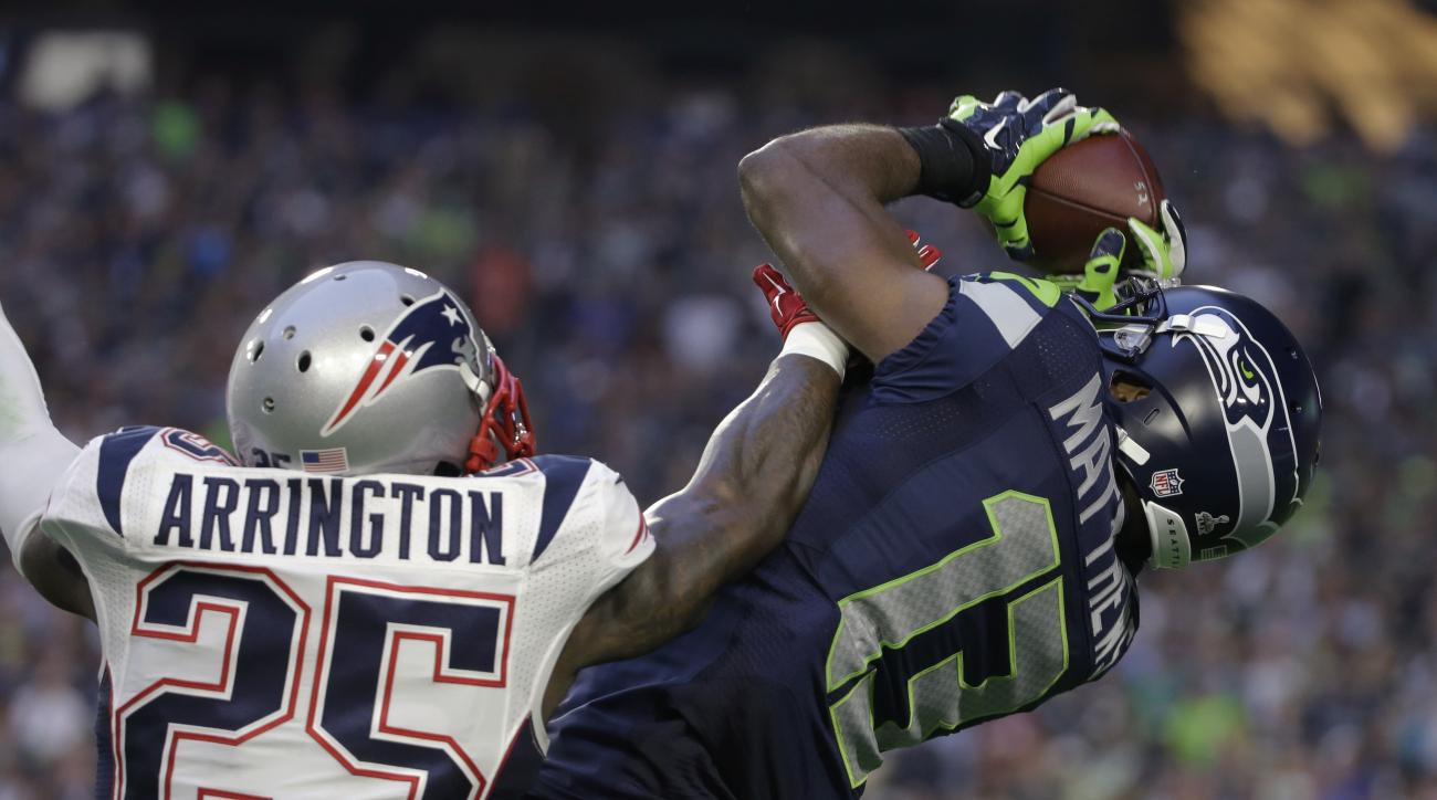 Seattle Seahawks wide receiver Chris Matthews (13) receives a pass against New England Patriots cornerback Kyle Arrington (25) during the first half of NFL Super Bowl XLIX football game Sunday, Feb. 1, 2015, in Glendale, Ariz. (AP Photo/Mark Humphrey)