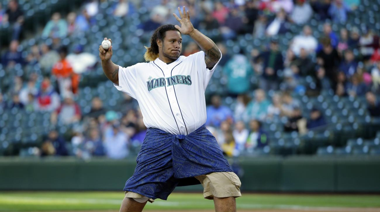 Cleveland Browns first-round draft pick Danny Shelton, a former defensive tackle from the University of Washington, throws out the ceremonial first pitch at a baseball game between the Seattle Mariners and the Boston Red Sox, Thursday, May 14, 2015, in Se