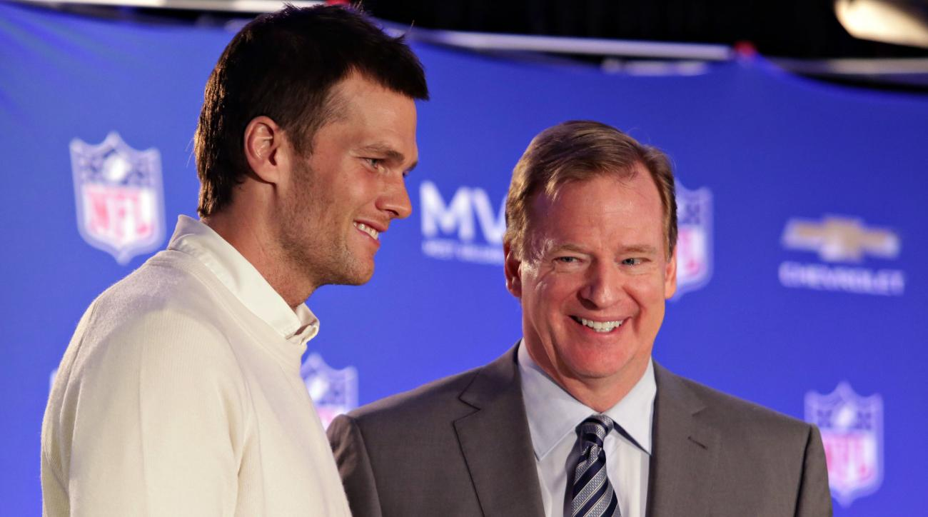 FILe - In this Feb. 2, 2015, file photo, New England Patriots quarterback Tom Brady, left, poses with NFL Commissioner Rodger Goodell during a news conference where Goodell presented Brady with the MVP award from the NFL Super Bowl XLIX football game. Bra