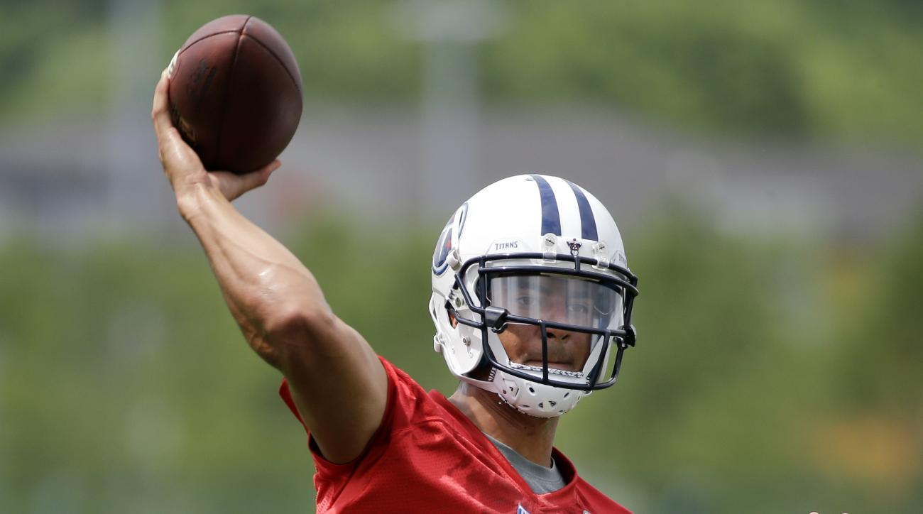 Tennessee Titans quarterback Marcus Mariota passes during a rookie minicamp practice Friday, May 15, 2015, in Nashville, Tenn. (AP Photo/Mark Humphrey)