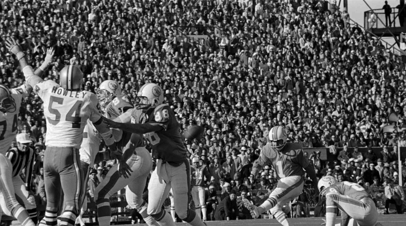 FILE - In this Jan. 16, 1972, file photo, Miami Dolphins' Garo Yepremian follows through on a field goal during the first half of the NFL football Super Bowl VI against the Dallas Cowboys in New Orleans. Holding is Dolphins Karl Noonan. Yepremian, the for