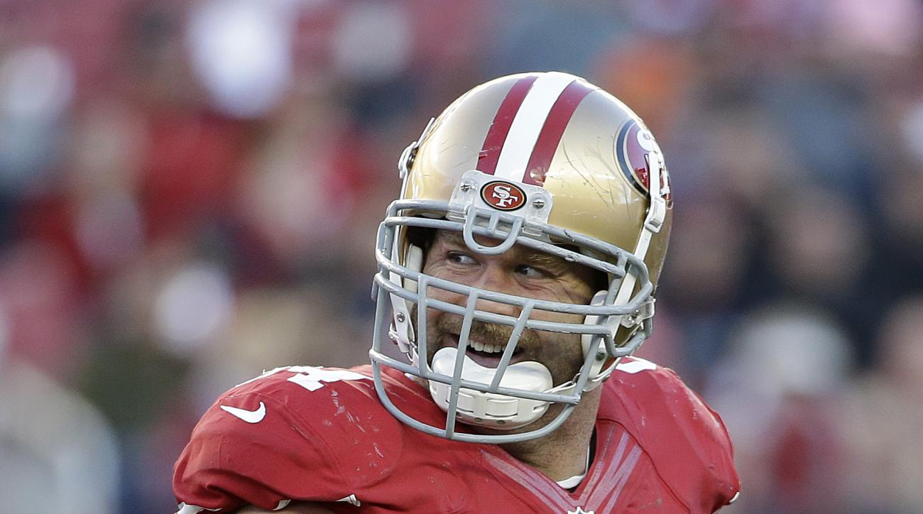 San Francisco 49ers defensive tackle Justin Smith (94) smiles during the second half of an NFL football game against the Arizona Cardinals in Santa Clara, Calif., Sunday, Dec. 28, 2014. (AP Photo/Marcio Jose Sanchez)