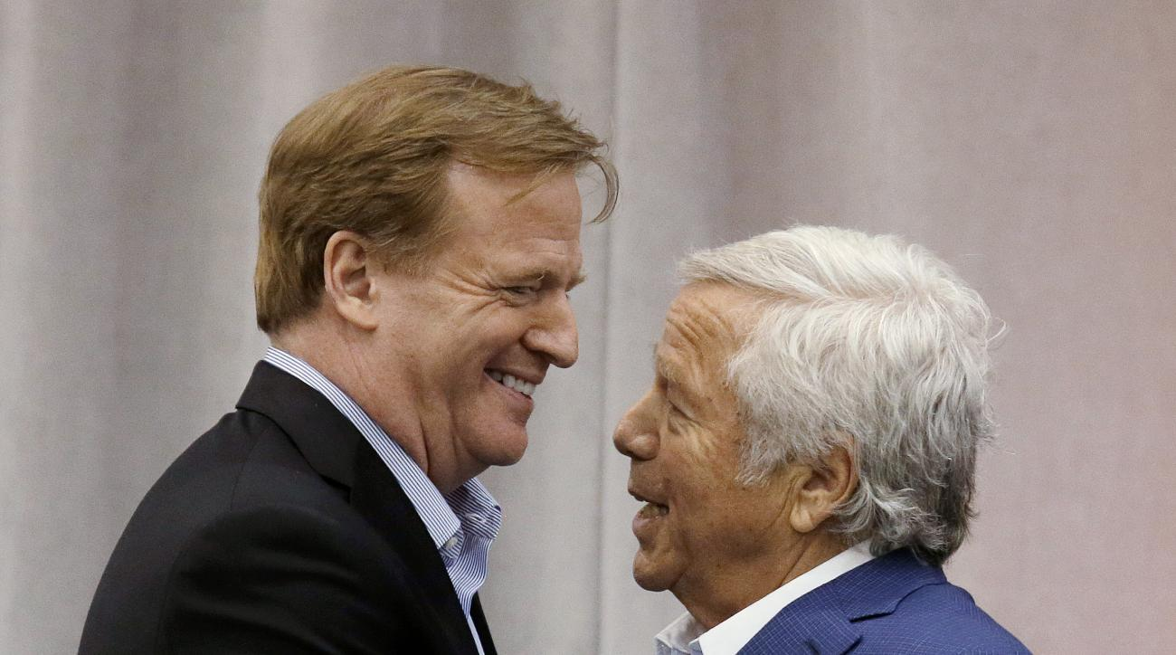 FO:e - In this May 29, 2014, file photo, New England Patriots owner Robert Kraft, right, introduces NFL Commissioner Roger Goodell at a football safety clinic for mothers at the team's facilities in Foxborough, Mass. Kraft and Goodell have worked closely