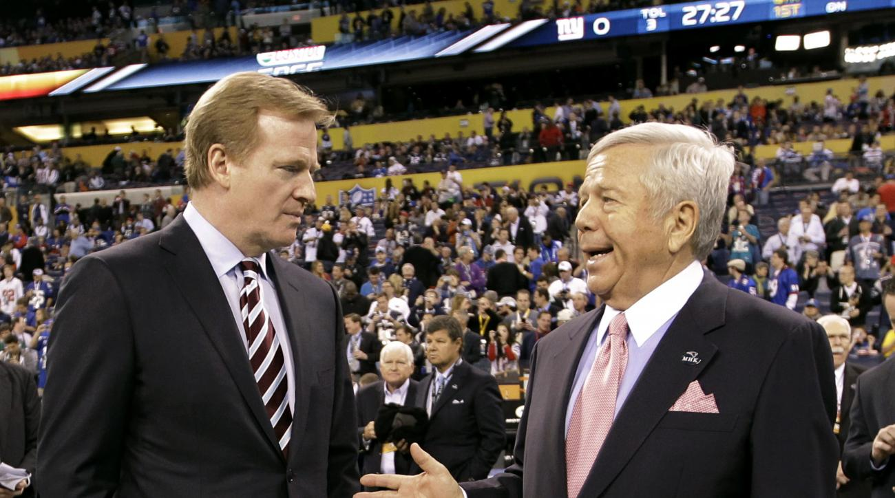 FILE - In this Feb. 5, 2012, file photo, NFL Commissioner Roger Goodell, left, talks with New England Patriots Chairman and CEO Robert Kraft before the NFL Super Bowl XLVI football game between the New York Giants and the New England Patriots in Indianapo