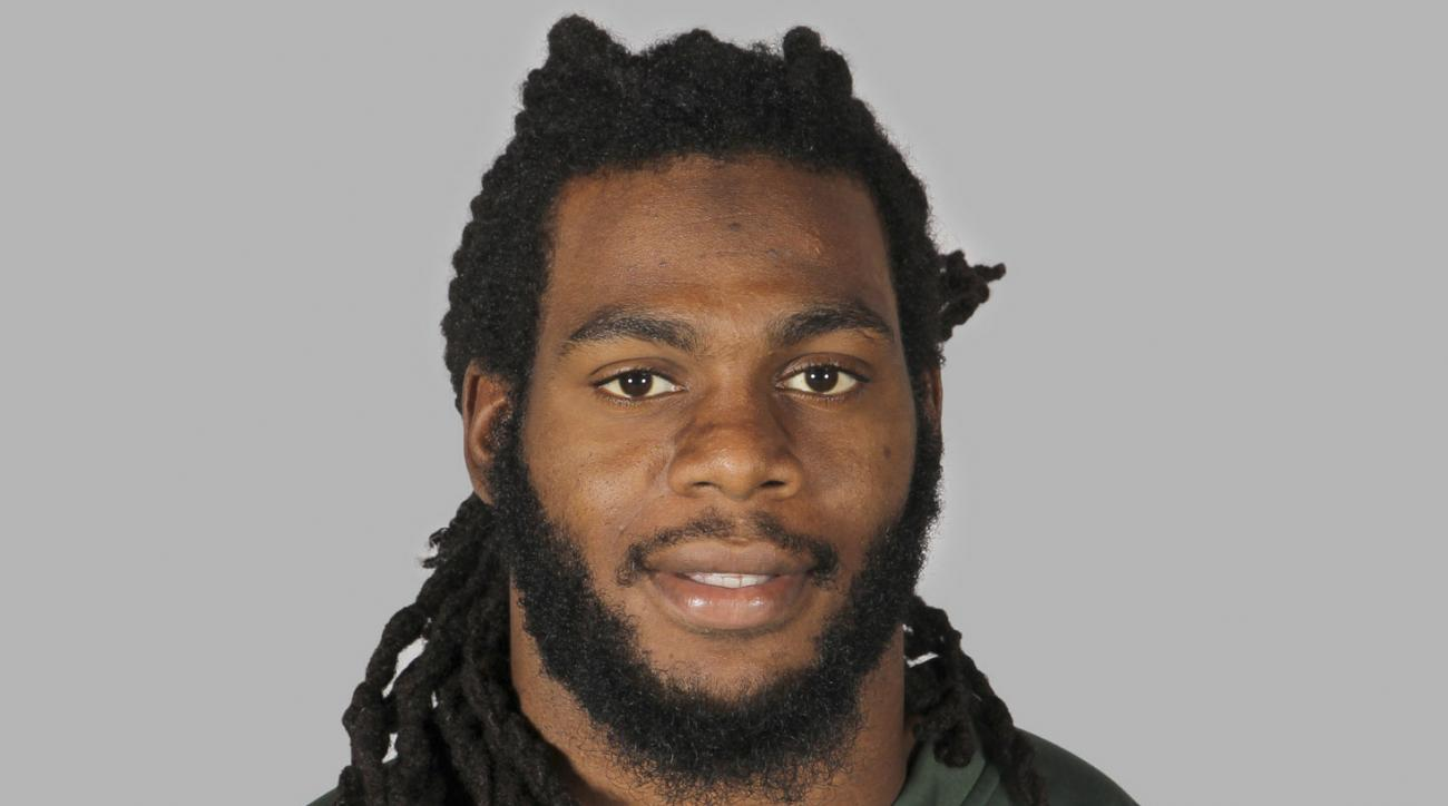 FILE - This June 16, 2014 file photo shows New York Jets linebacker Jermaine Cunningham in Forham Park, N.J.  Cunningham, a former New York Jets linebacker has pleaded guilty to three charges in connection with a domestic dispute that invoked New Jersey's