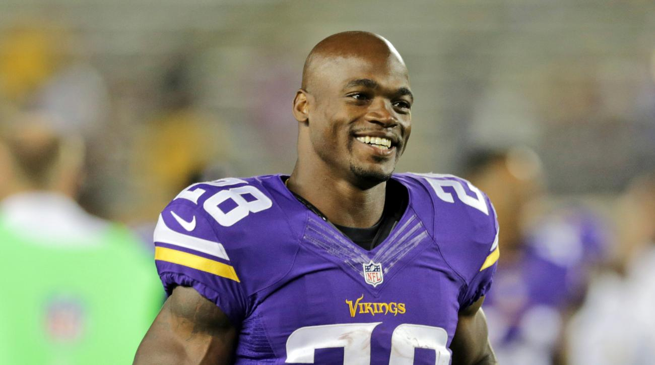 FILE - In this Aug. 8, 2014, file photo, Minnesota Vikings running back Adrian Peterson leaves the field after an NFL preseason football game against the Oakland Raiders in Minneapolis. The Minnesota Vikings will open their optional team practices this we