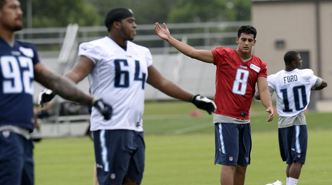 Tennessee Titans quarterback Marcus Mariota (8) stretches during an organized team activity at the team's NFL football training facility Tuesday, May 26, 2015, in Nashville, Tenn. (AP Photo/Mark Zaleski)