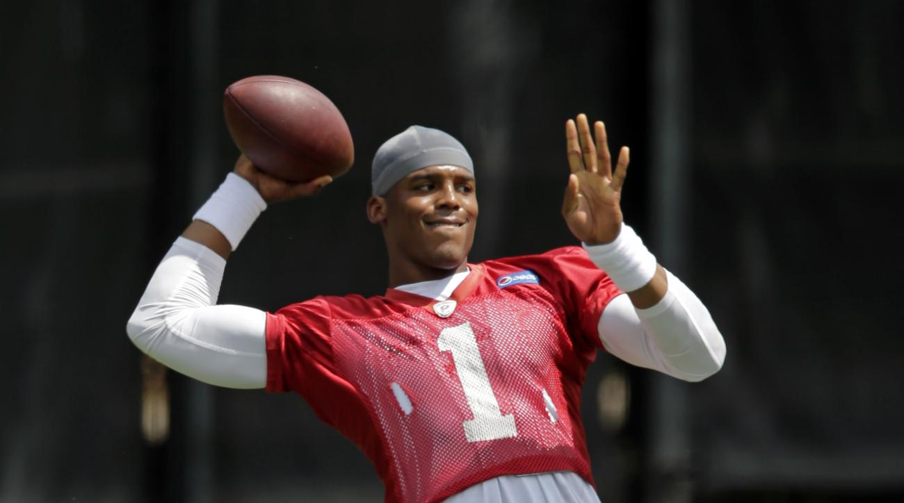 Carolina Panthers' Cam Newton throws a pass during the NFL football team's practice in Charlotte, N.C., Thursday, May 28, 2015. (AP Photo/Chuck Burton)