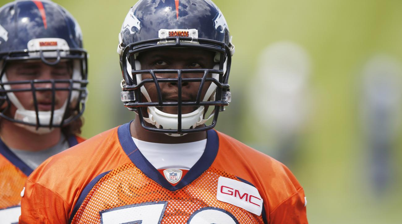 In this photo taken Wednesday, May 27, 2015, Denver Broncos offensive tackle Ryan Clady waits to take part in drills during an NFL football organized team activity at the team's headquarters in Englewood, Colo. Broncos officials announced Thursday, May 28