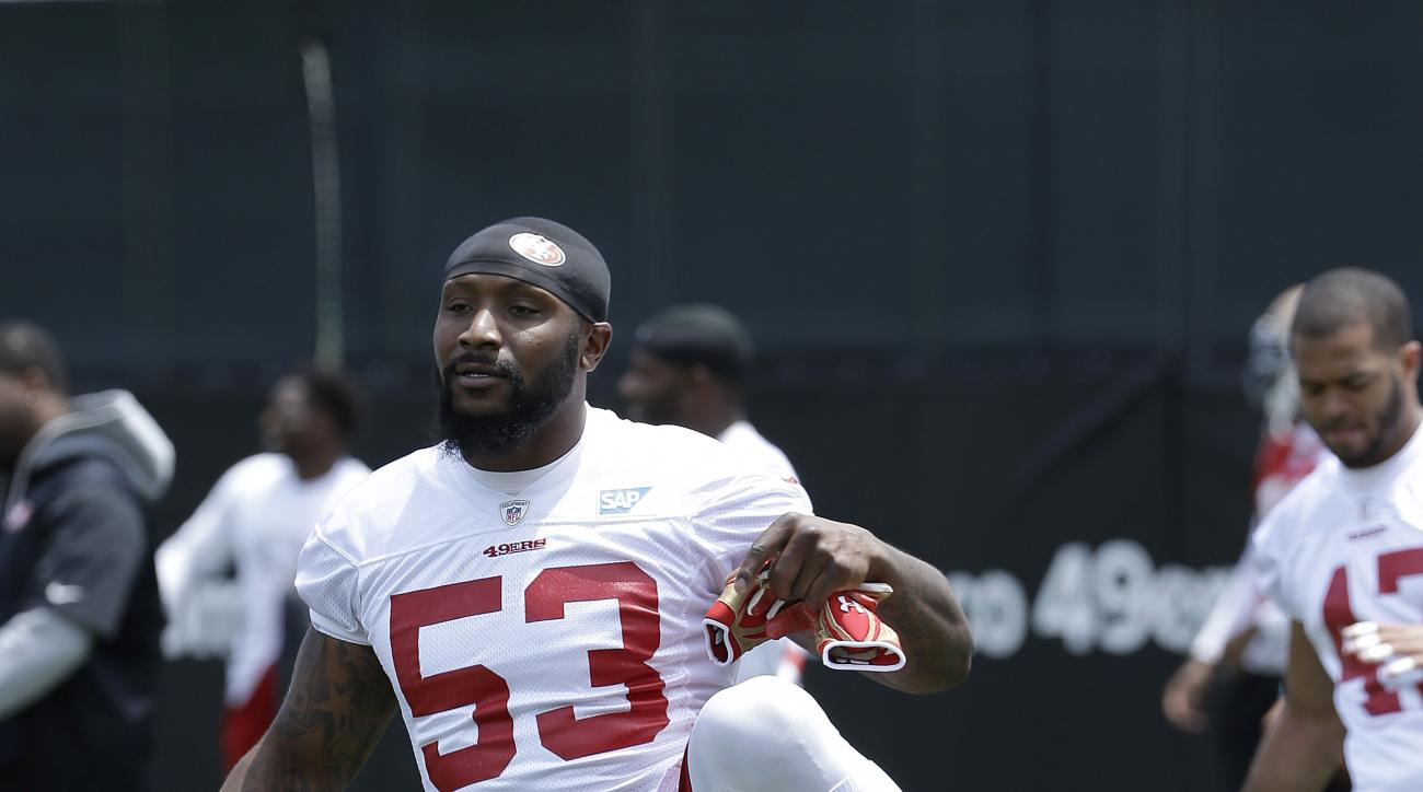 San Francisco 49ers linebacker NaVorro Bowman (53) stretches during practice at an NFL football facility in Santa Clara, Calif., Friday, May 29, 2015. (AP Photo/Jeff Chiu)