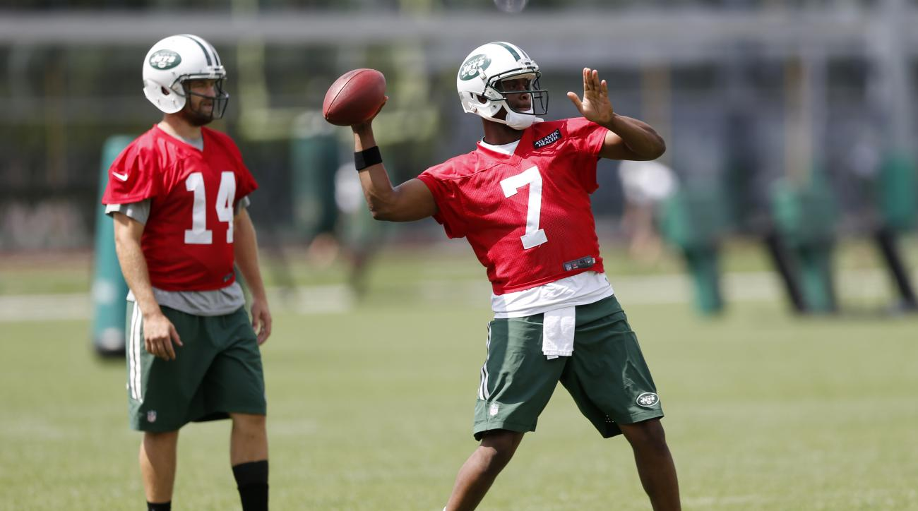 New York Jets Geno Smith, right, throws as quarterback Ryan Fitzpatrick looks on during organized team activities at the team's NFL football training center, Wednesday, June 3, 2015, in Florham Park, N.J. (AP Photo/Julio Cortez)