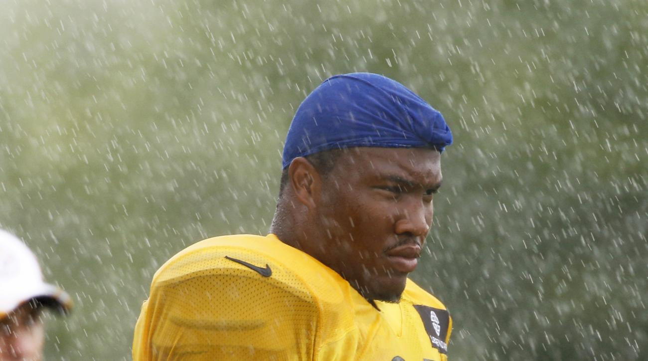 FILE - In this July 28, 2014, file photo,  Pittsburgh Steelers defensive tackle Stephon Tuitt (91) stands in the rain during NFL football training camp in Latrobe, Pa. The Steelers are banking on Tuitt's learning curve accelerating after they cut Brett Ke