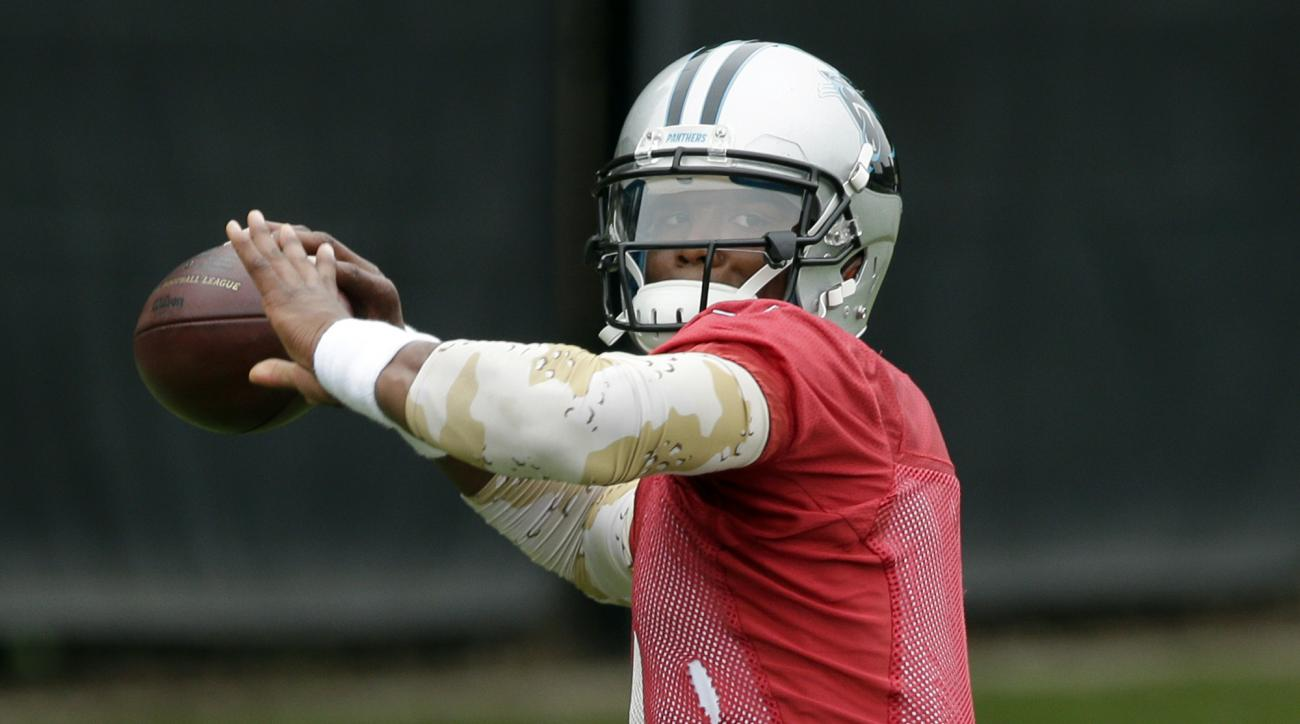 Carolina Panthers' Cam Newton throws a pass during an NFL football organized team activity in Charlotte, N.C., Thursday, June 4, 2015. After getting a $103.8 million contract from the Panthers, the pressure is on Newton to produce.  (AP Photo/Chuck Burton
