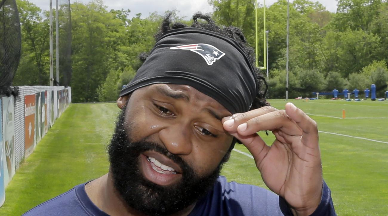 New England Patriots linebacker Brandon Spikes talks with reporters after an NFL football organized team activity Friday, May 29, 2015, in Foxborough, Mass. (AP Photo/Elise Amendola)