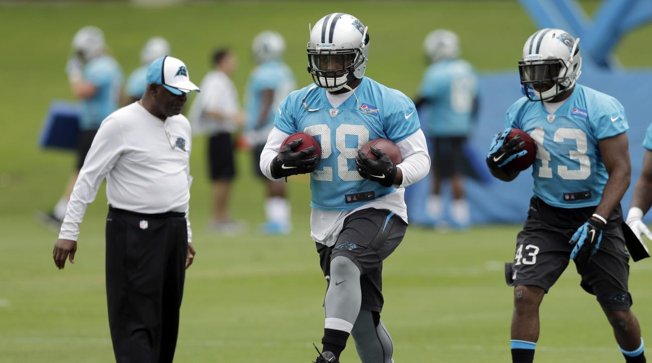 Carolina Panthers' Jonathan Stewart, center, runs a drill during an NFL football organized team activity in Charlotte, N.C., Monday, June 8, 2015. Stewart is the unquestioned No. 1 running back for the Panthers now that DeAngelo Williams is gone. Stewart