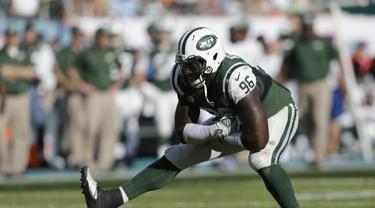 New York Jets defensive end Muhammad Wilkerson (96) celebrates after sacking Miami Dolphins quarterback Ryan Tannehill during the second half of an NFL football game, Sunday, Dec. 28, 2014, in Miami Gardens, Fla. (AP Photo/Wilfredo Lee)