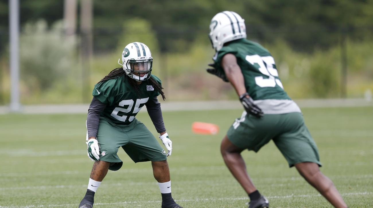 New York Jets free safety Calvin Pryor, left, lines up against safety Durell Eskridge during a mandatory minicamp at the NFL football team's facility, Tuesday, June 9, 2015, in Florham Park, N.J. (AP Photo/Julio Cortez)