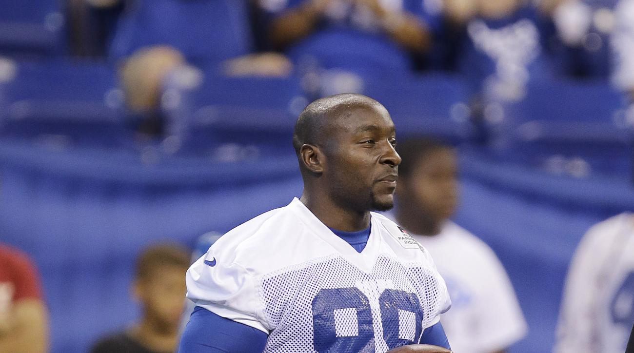 Indianapolis Colts' Robert Mathis watches during an NFL football organized team activity Wednesday, June 10, 2015, in Indianapolis. (AP Photo/Darron Cummings)