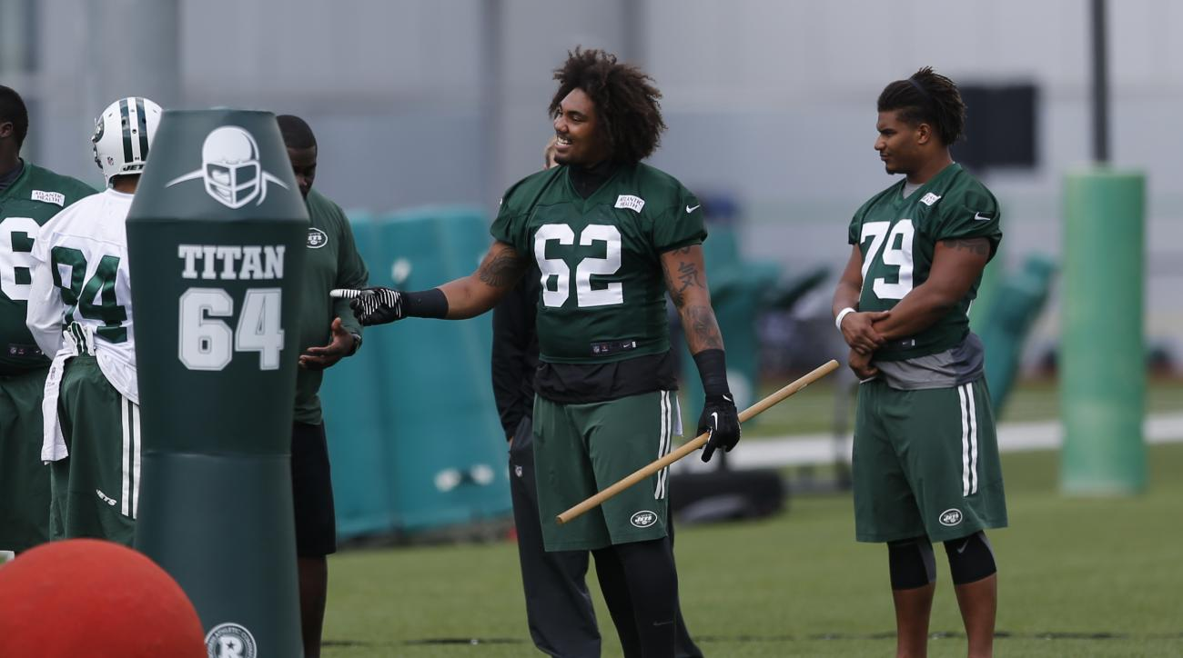 FILE - In this June 3, 2015, file photo, New York Jets defensive lineman Leonard Williams holds a stick during an NFL football organized team activities at the team's training center in Florham Park, N.J. Williams, a star defensive lineman from USC, is ex
